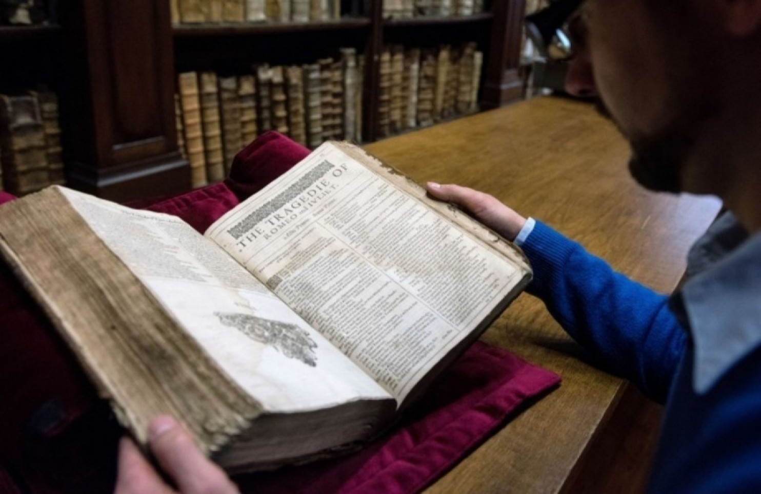 Remy Cordonnier shows a valuable Shakespeare First Folio, a collection of some of his plays that dates to 1623. Around 230 copies are known to exist in collections or in private hands around the world. (AFP PHOTO/DENIS CHARLET)